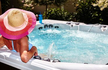 a woman in a hat relaxing in her hot tub in El Dorado, California
