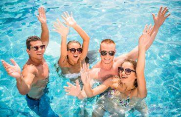 four friends having fun in their swim spa in Fair Oaks
