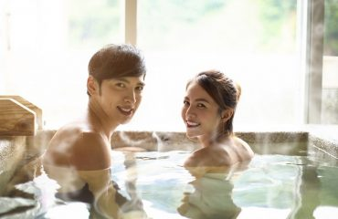 couple in hot tub during winter