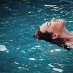 Woman floating in a swim spa.